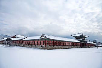 Red wooden house at winter season