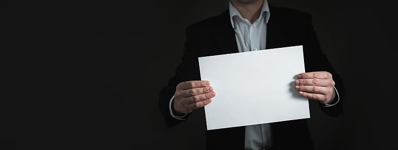 Person holding white blank paper