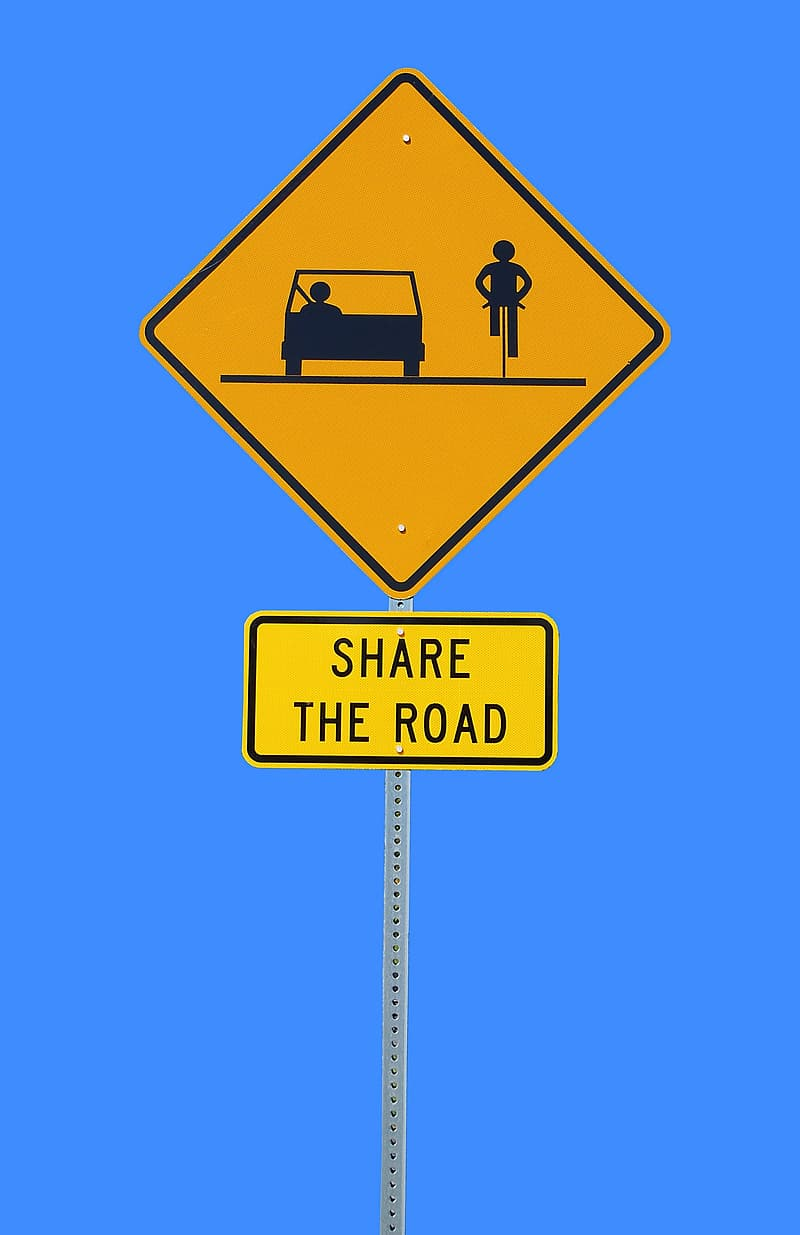 Yellow Share the road printed road signage