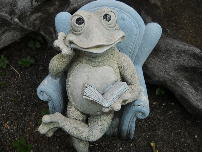 Blue frog figurine on green grass