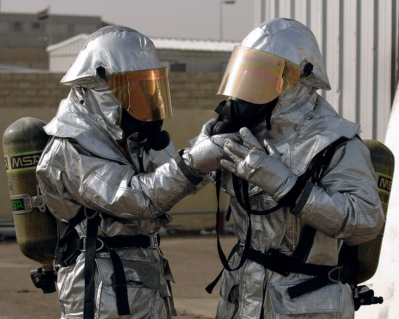 Two person wearing hazard suits
