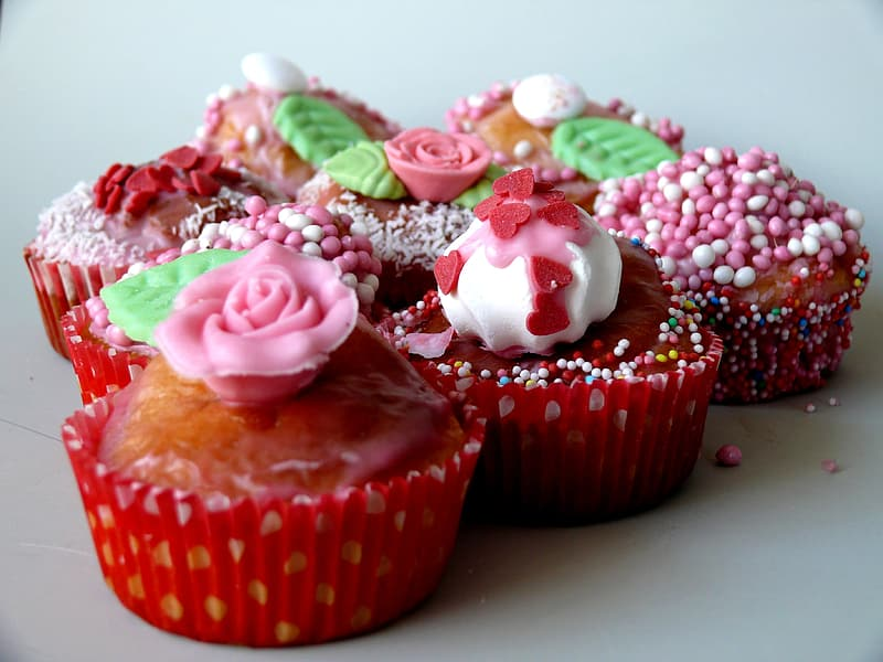 Six floral topped cupcakes