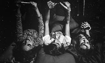 Grayscale photo of a group of women