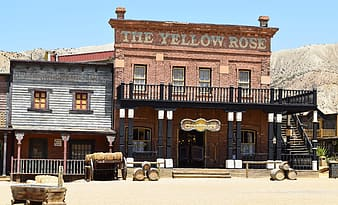 The Yellow Rose restaurant facade with barrels decor
