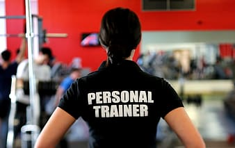 Focus photo of woman wearing Personal Trainer shirt