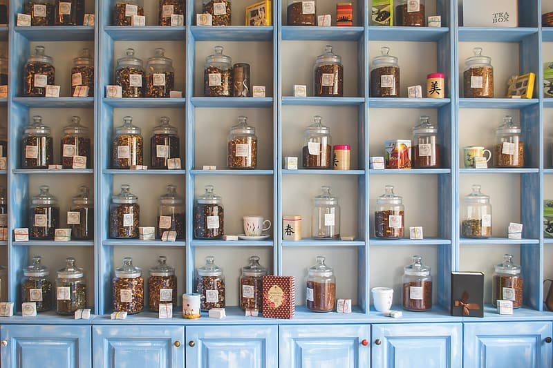 Brown wooden shelf with jars