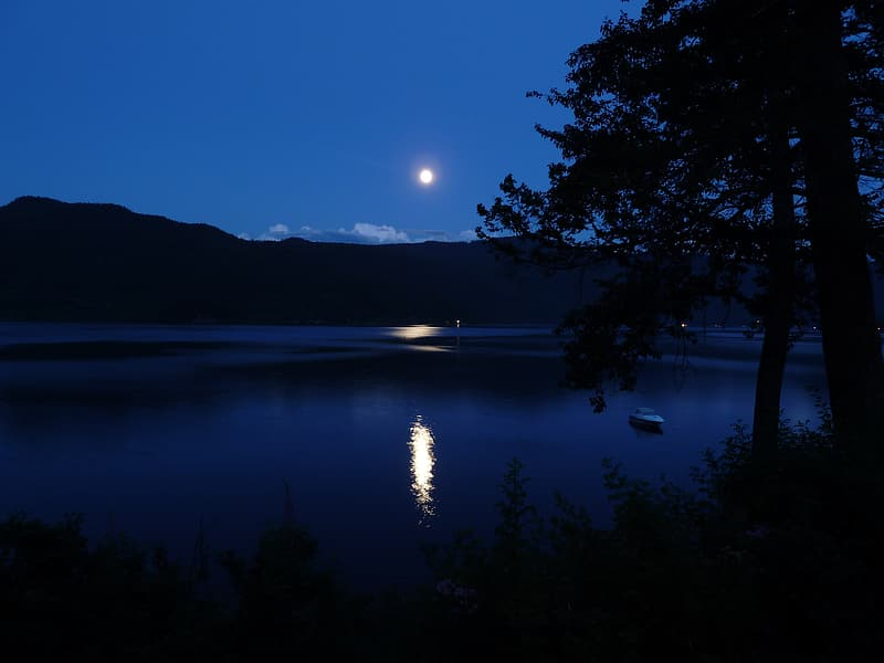 Body of water and mountains during night time