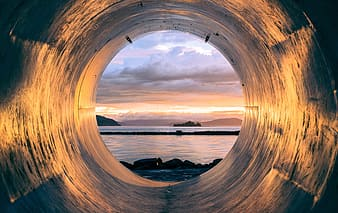 Inside the hole photo of body of water during sunset