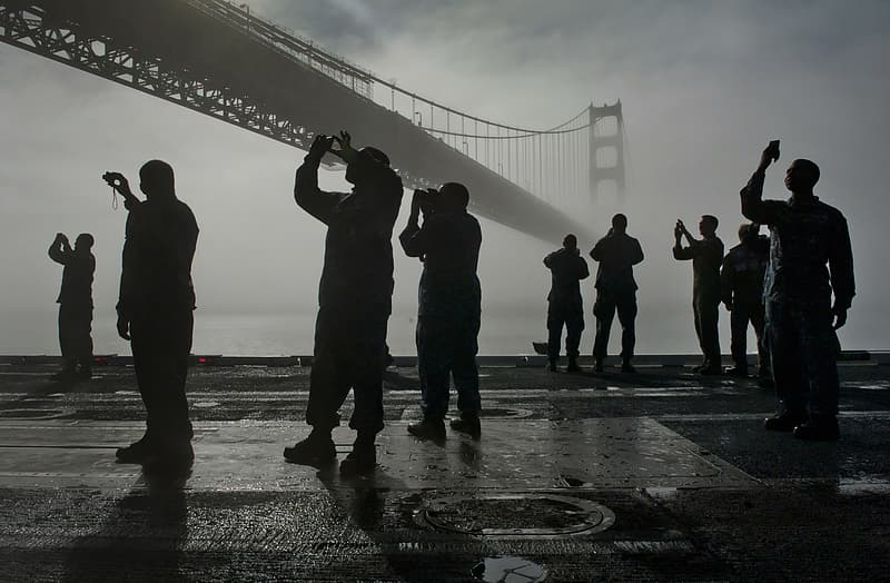 People taking photo of the Golden Gate Bridge in San Francisco, U.S.A. during foggy day