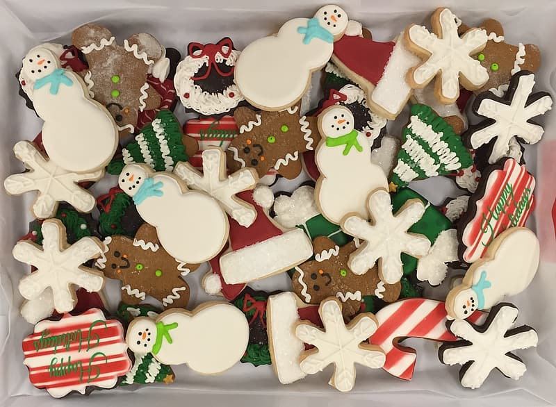 Assorted-shape Christmas-themed cookies on tray