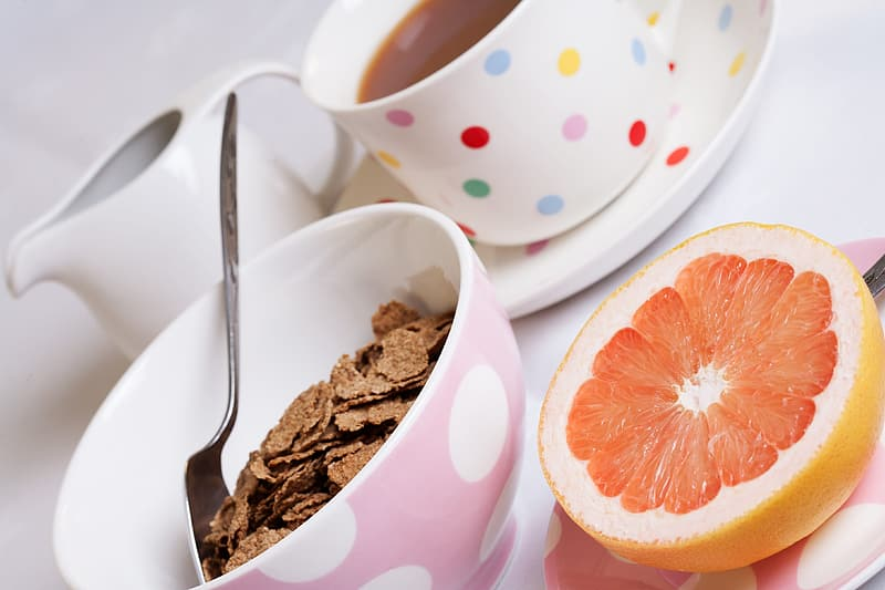 Choco flakes cereal beside stainless steel spoon on white ceramic bowl