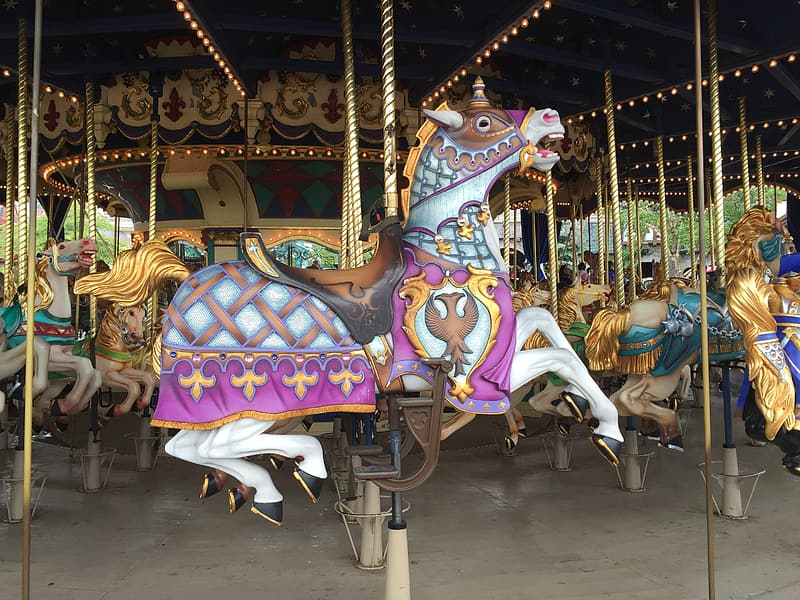 White and pink ride-on horse carousel