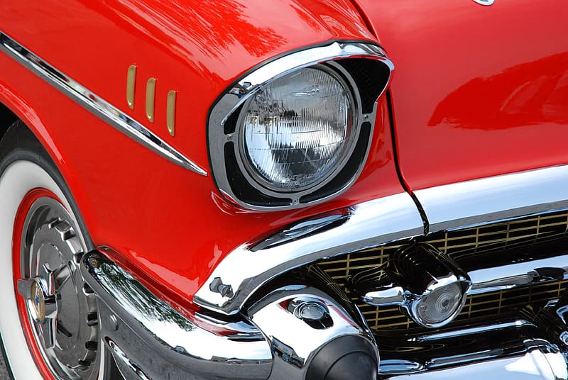 Chrome bumper on red car