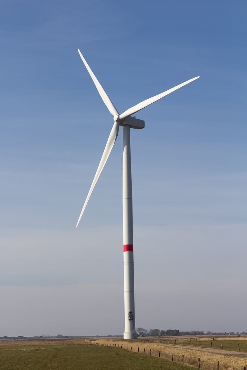 White windmill on field during daytime
