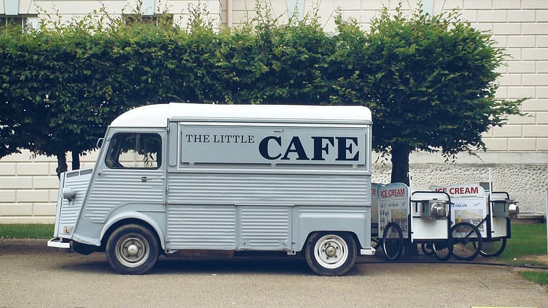 Gray the little cafe printed food truck near trees
