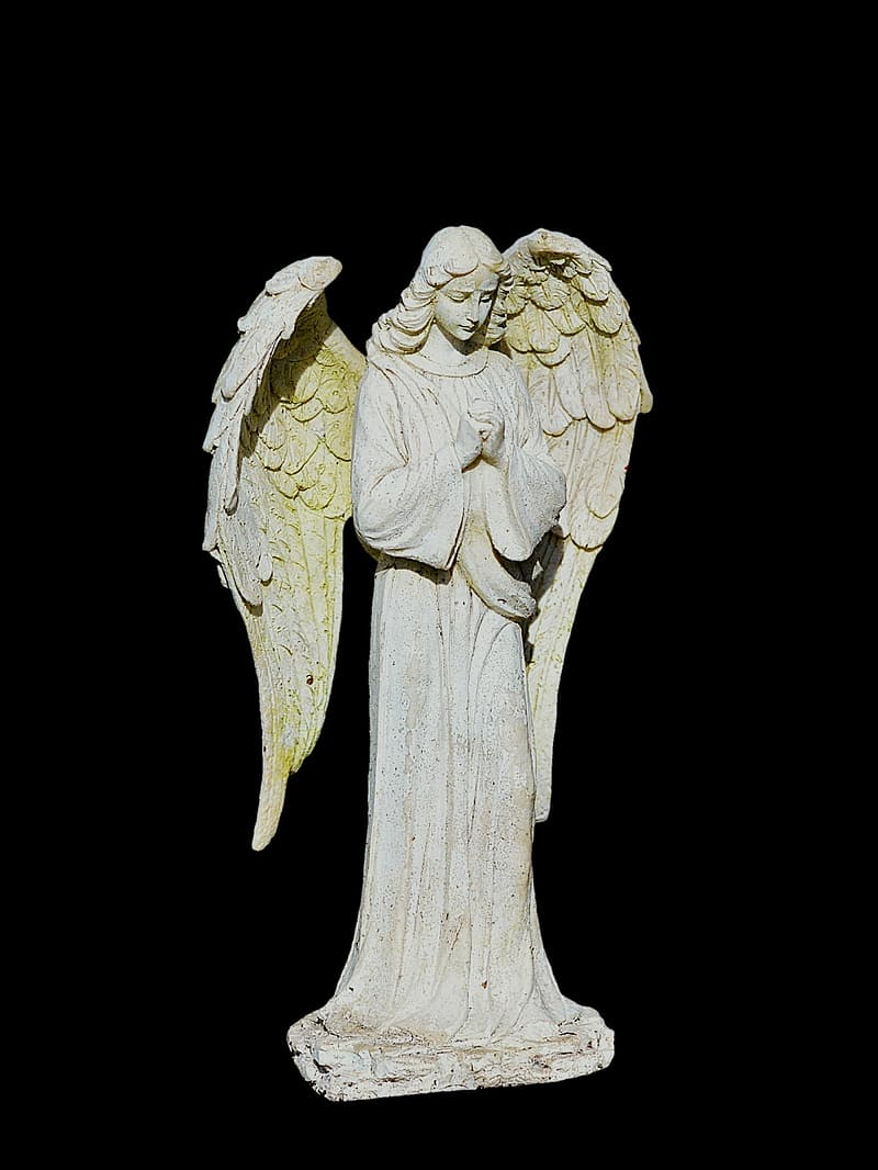 White angel statue on black background