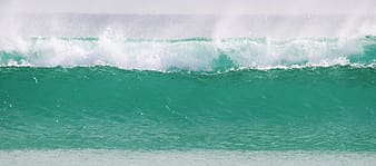 Photography of wave body of water