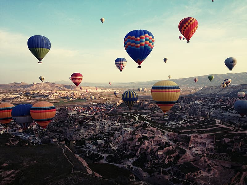 Hot air balloons on sky during golden hour