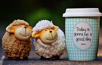 Two white and brown sheep figurines