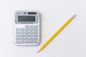 White and black canon calculator beside yellow pencil