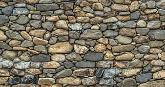 Photo of brown and black stone wall