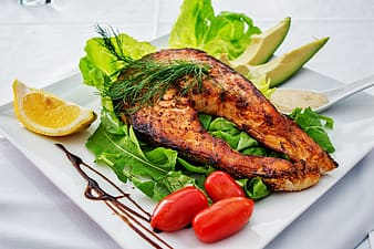 Roasted fish meat on white plate