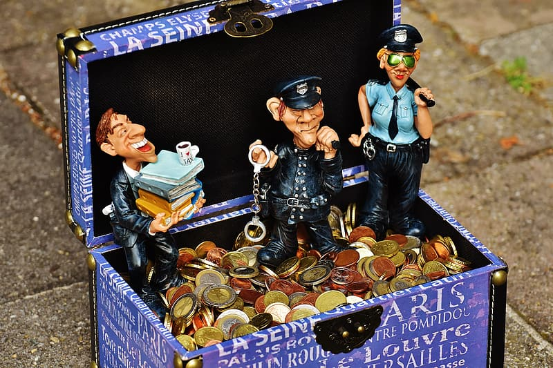 Two police standing on chest with coins decor