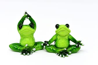 Two green frog ceramic figurines