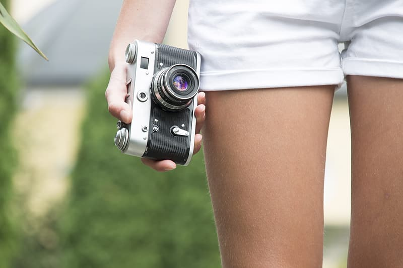 Person holding mirrorless camera