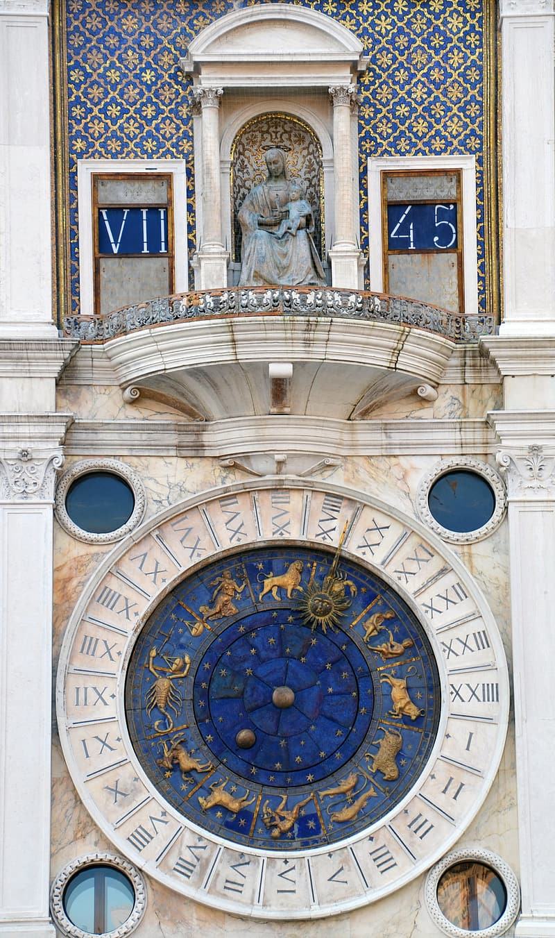 Blue and white zodiac sign building