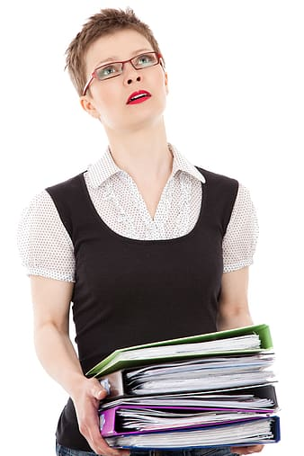 Woman wearing black and white collared shirt holding book binders