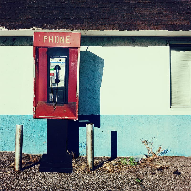 Red and black telephone booth