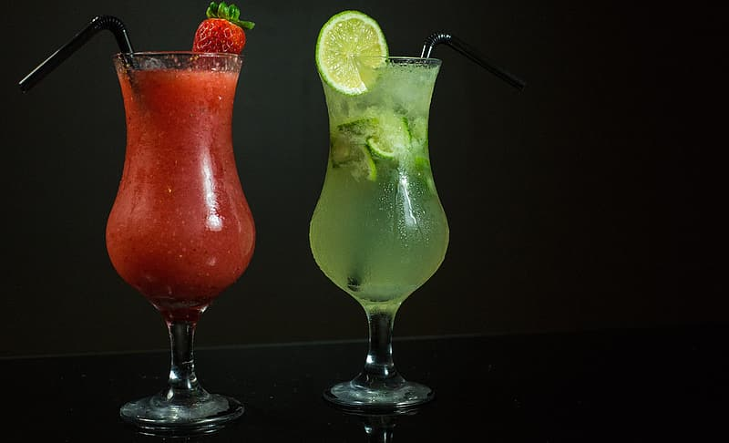 Two strawberry and lime flavored glasses