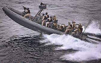 Navy army on gray power boat