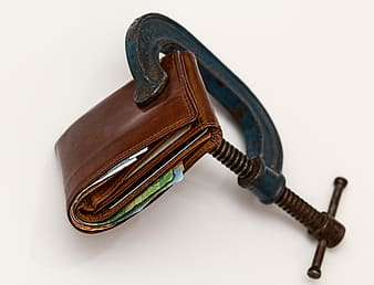 Brown leather wallet clamp in C-clamp