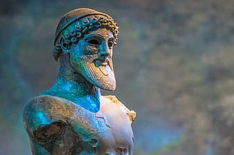 Blue and brown human face statue