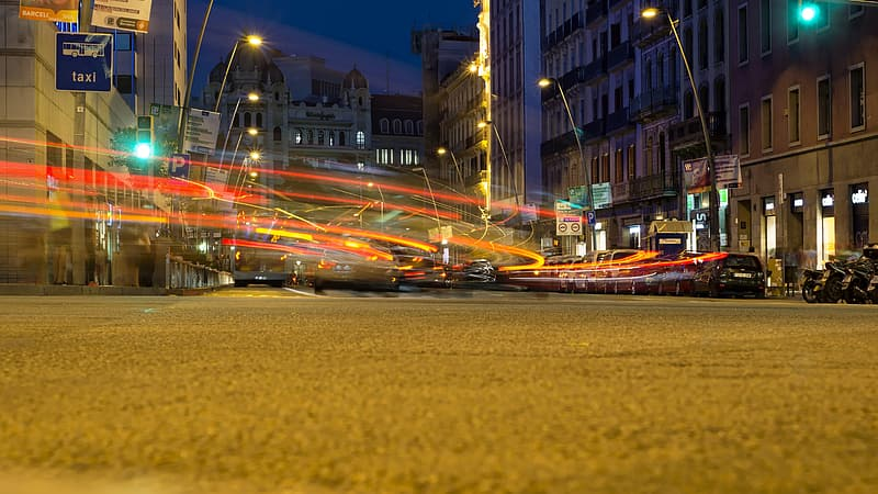 Timelapse photography of cars passing by the street