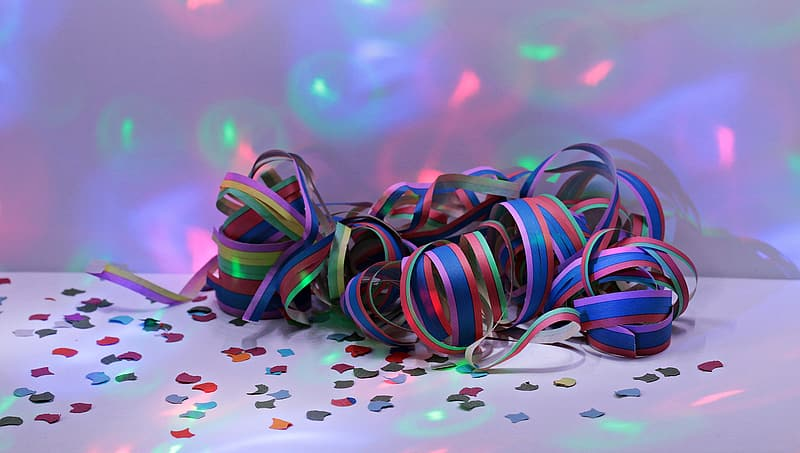 Multicolored ribbon on top of white surface with lights