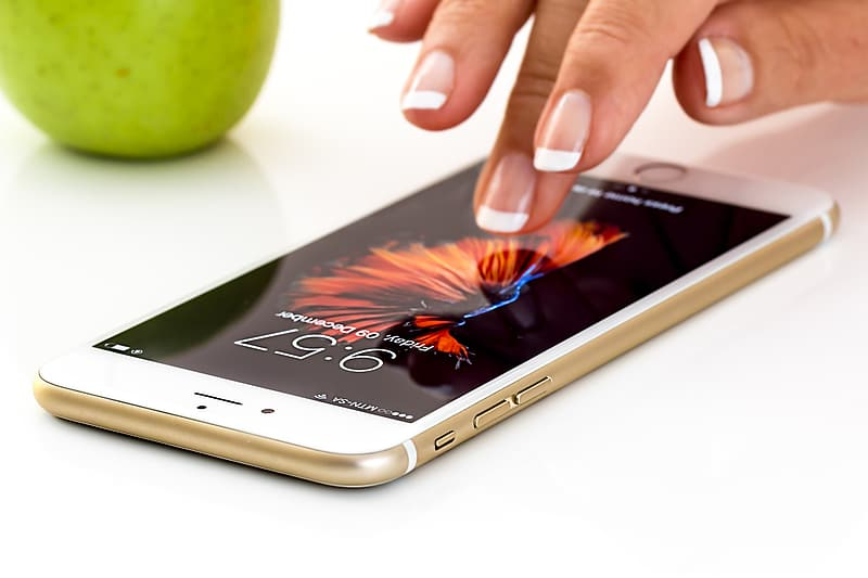 Person touching gold iPhone 6