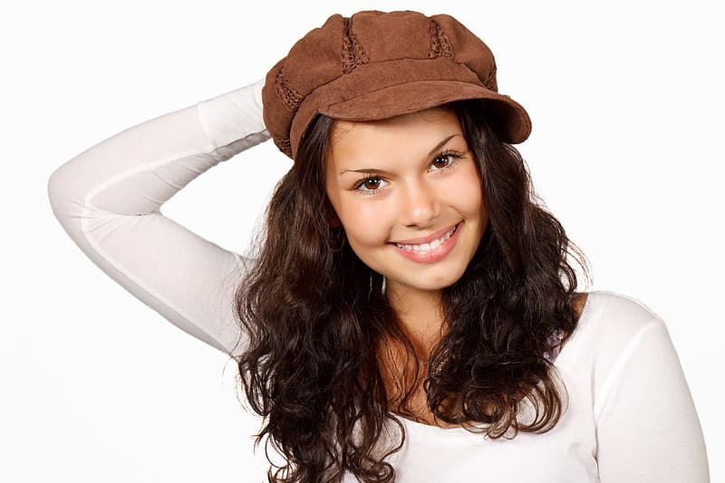 Woman in white scoop-neck long-sleeved top and brown hat