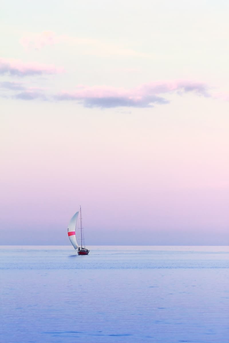 Sailboat at the center of body of water