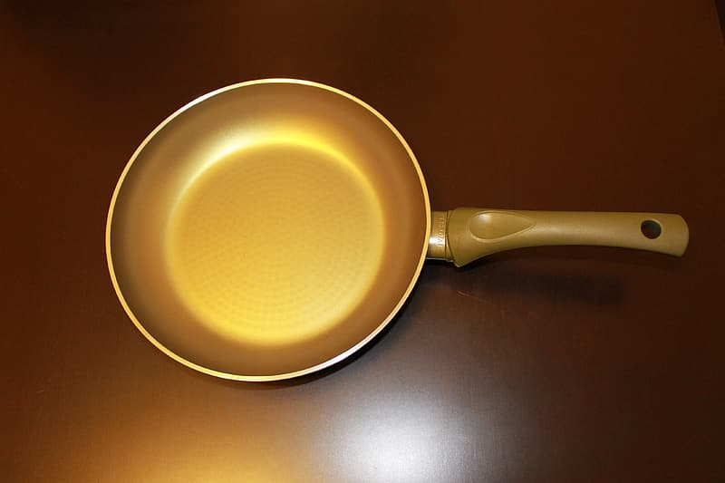 Frying pan on brown surface