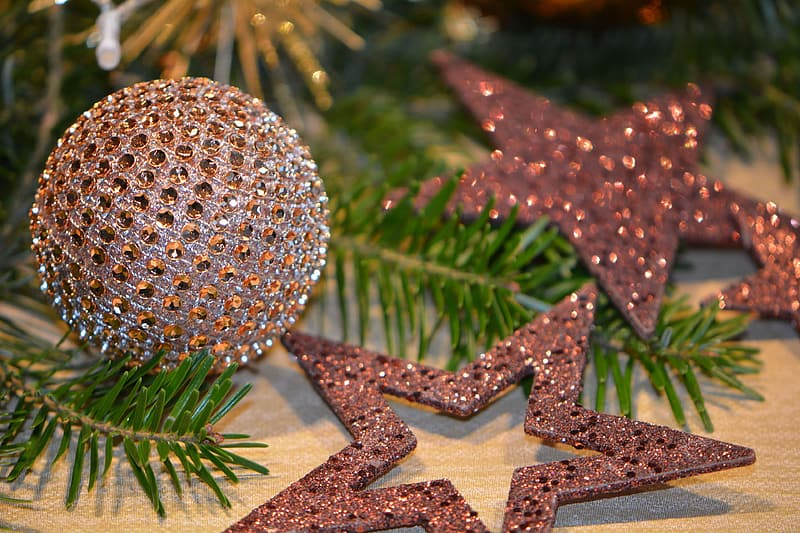 Silver glittered christmas bauble on white star print textile