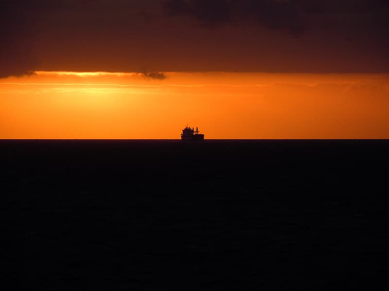 Silhouette of fishing boat during sunset