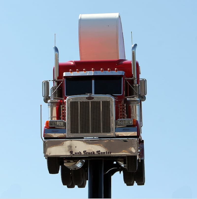 Red and white truck on black metal post
