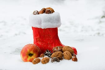 Unpaired red boot with walnuts