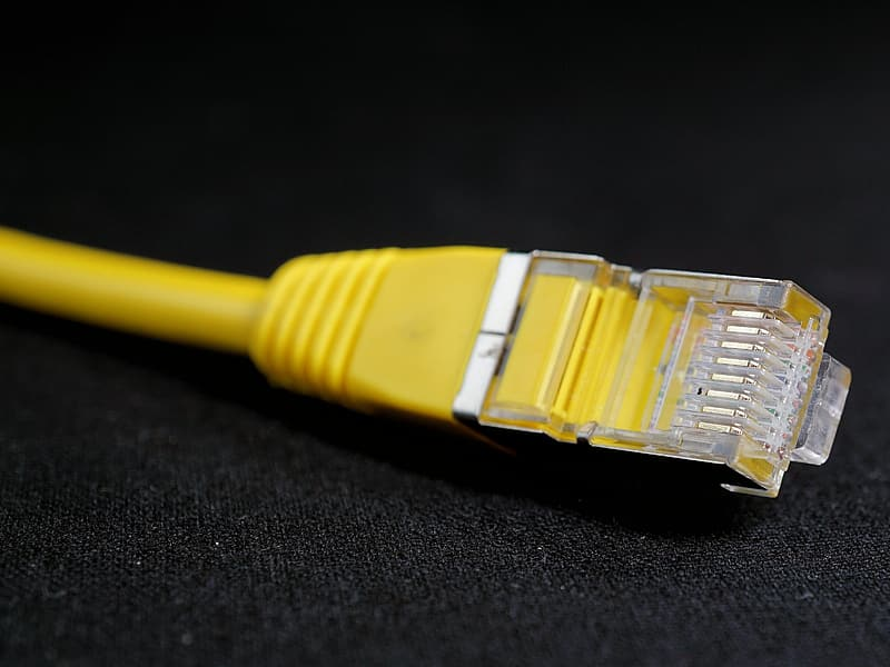 Yellow ethernet cable on black surface