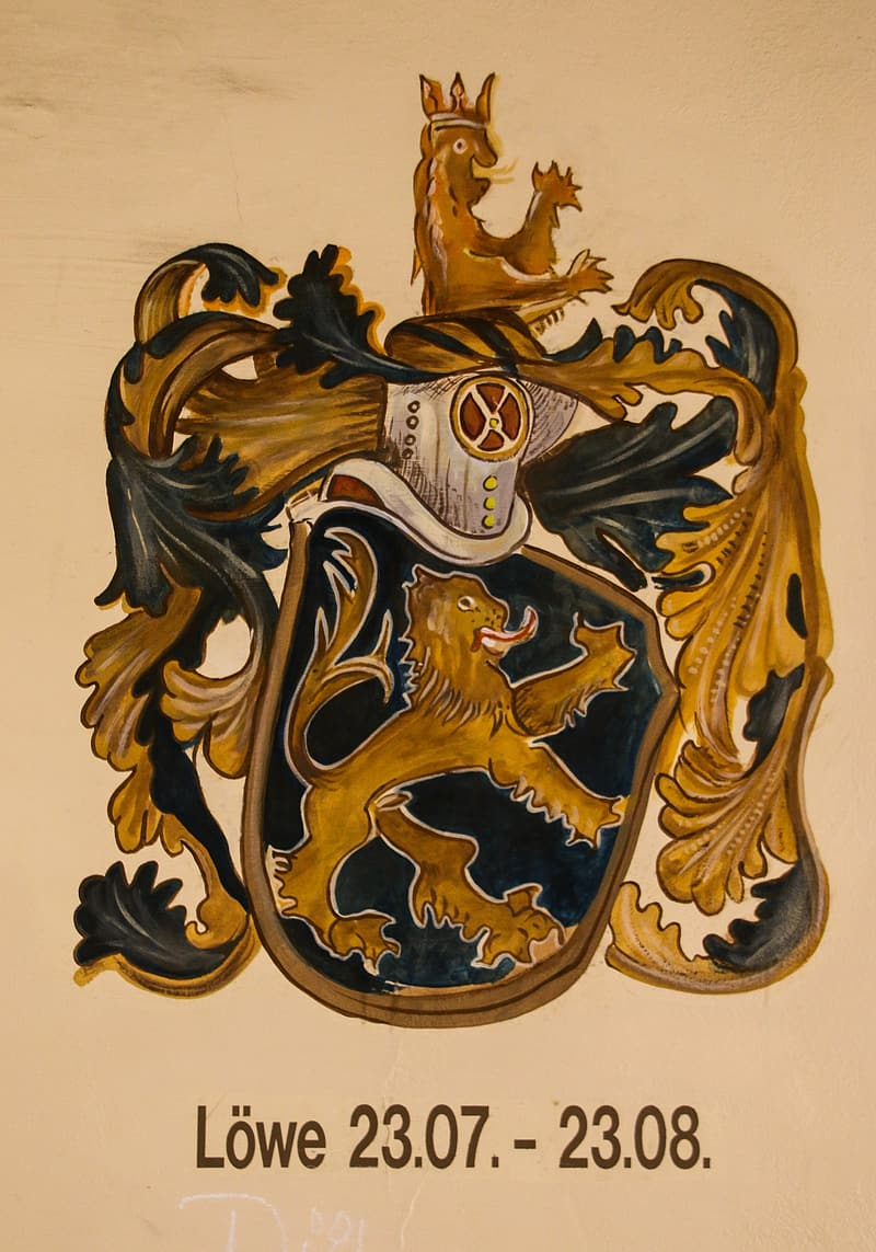 Black and brown coat of arms painting