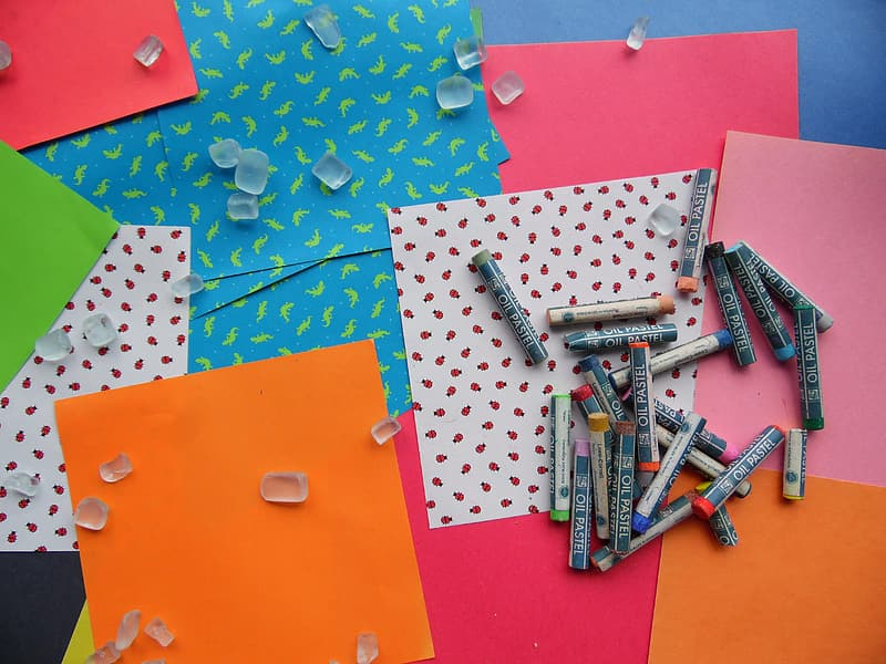 Photo of assorted color crayons and papers