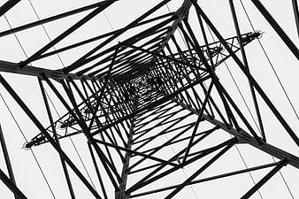 Low-angle photography of gray metal tower